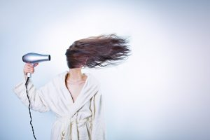 woman blowdrying hair funny